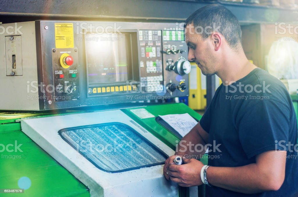 The man working on cnc milling machine stock photo