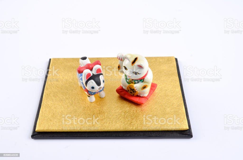the manekineko and inuhariko isolated stock photo