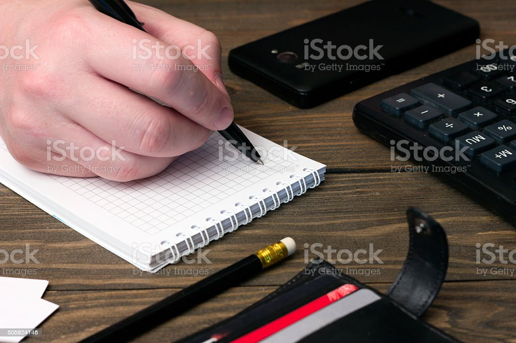 the man's hand , a notebook with a ballpoint pen , wallet stock photo
