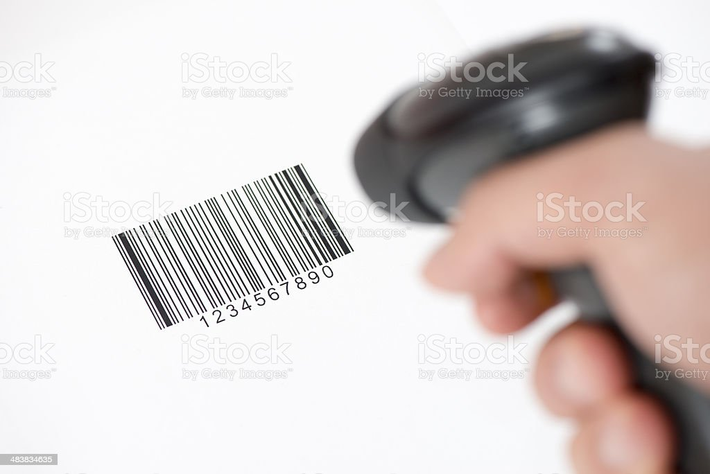 The manual scanner of bar codes in man hand stock photo