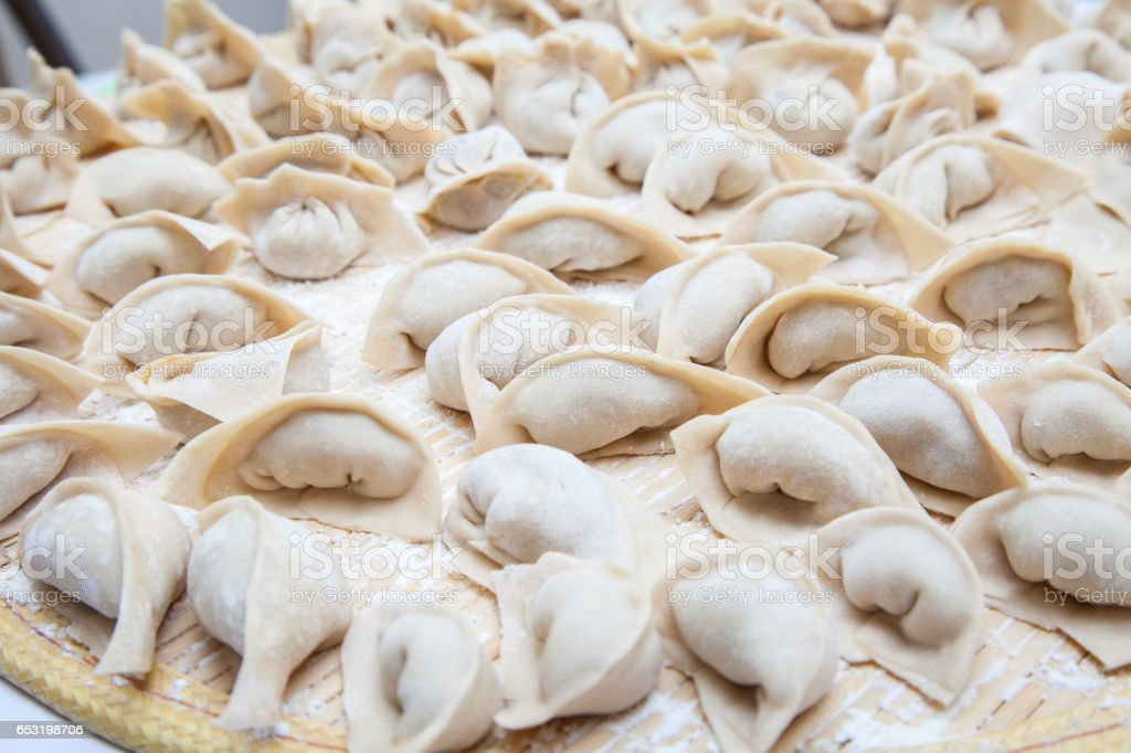 The many Fresh hand made Chinese dumplings. stock photo