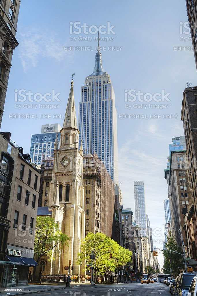 The Marble Collegiate Church and Empire State building in Manhat royalty-free stock photo