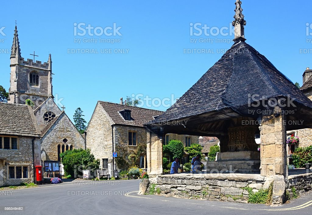 The Market Cross and St Andrews Church, Castle Combe. stock photo