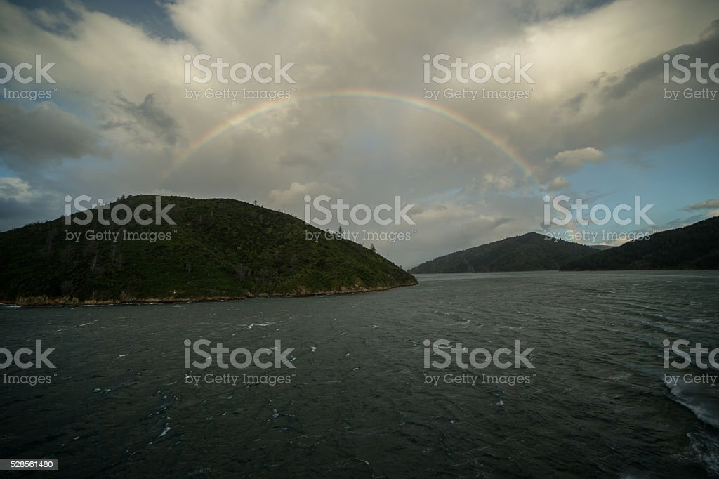 The Marlborough sounds under beautiful rainbow stock photo
