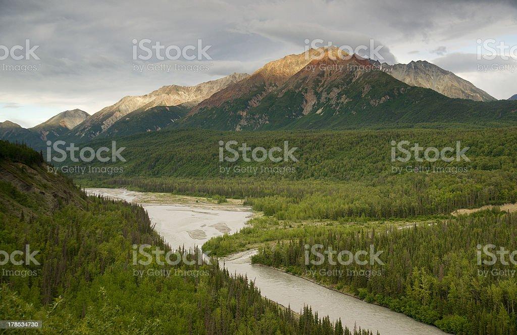 The Matanuska River cuts Through Woods at Chugach Mountains Base stock photo