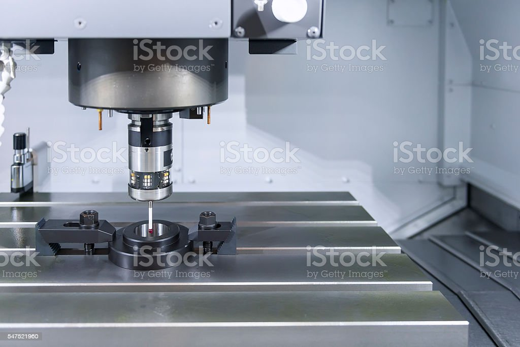 The measurement probe on the CNC machine for calibration. stock photo
