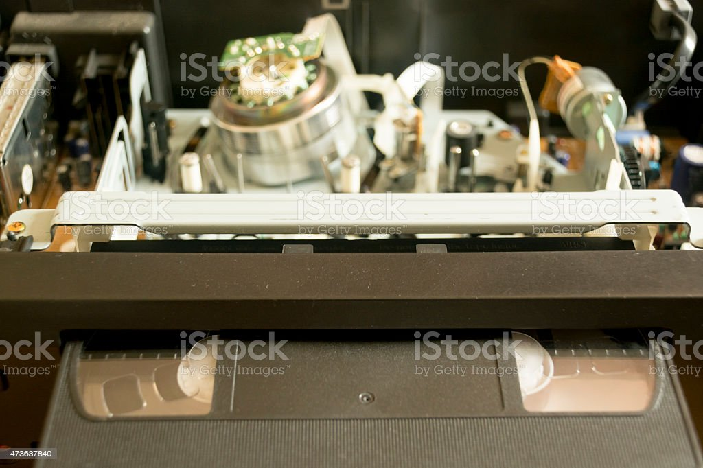 The mechanism of a VCR and a video cassette stock photo