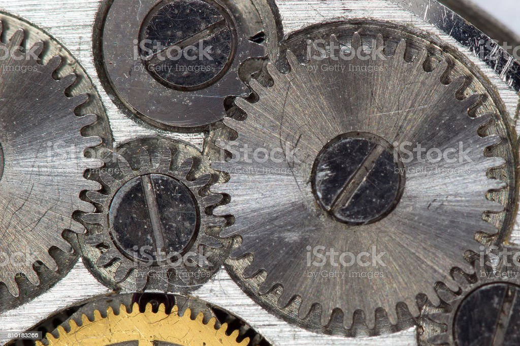 The mechanism of the old clock on a large scale stock photo