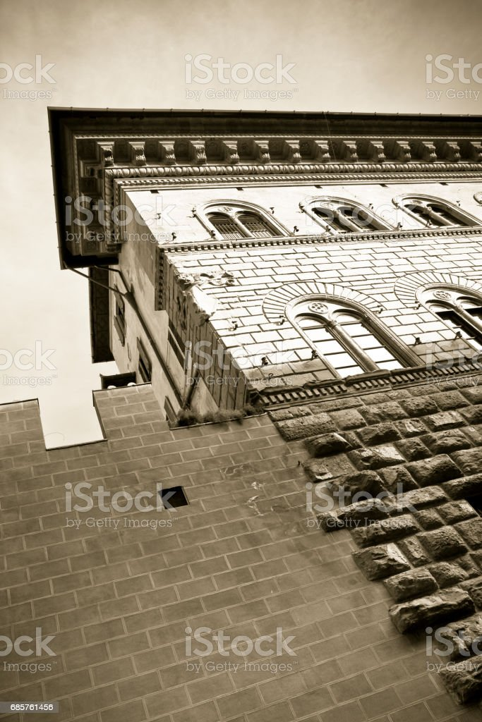 The Medici Riccardi's Palace in Florence: a magnificent example of Renaissance architecture (Italy-Tuscany-Florence) - sepia toned stock photo