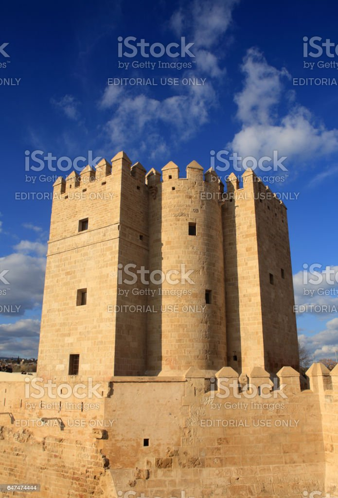 Cordoba, Spain - February 27, 2017: The medieval Calahorra Tower guards the Roman Bridge which spans the Guadalquivir River. The tower is a UNESCO World Heritage site and popular tourist attraction. stock photo