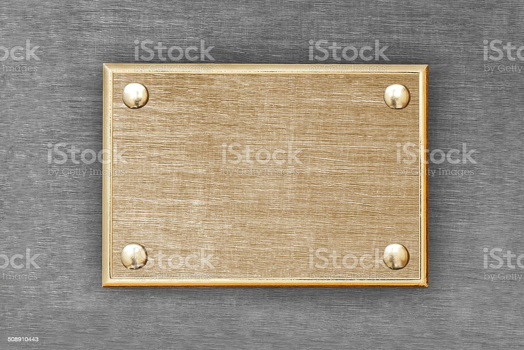 The metal plate of golden color stock photo
