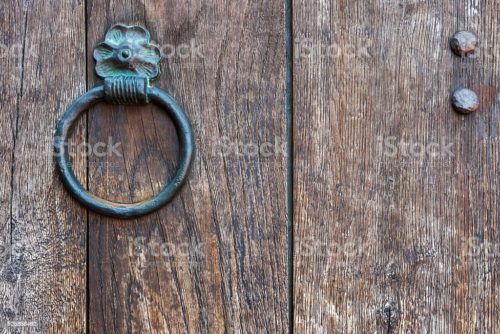 The metal ring on a wooden door stock photo