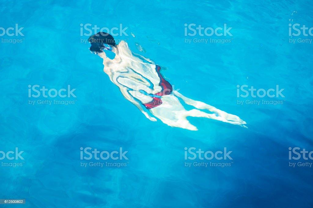 The metamorphosis of the man in water stock photo
