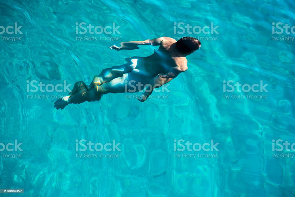 The metamorphosis of the man in water stock photo