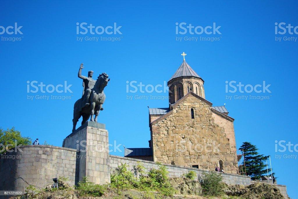 The Metekhi Temple and the Gorgasali Monument in Tbilisi, Georgia. stock photo