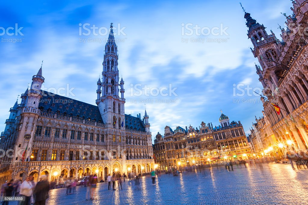 La Meuse et l'Escaut on Grand Place at night stock photo
