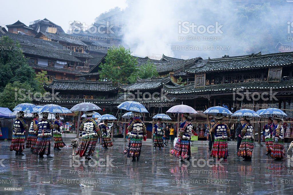 The Miao women dancing in the rain stock photo