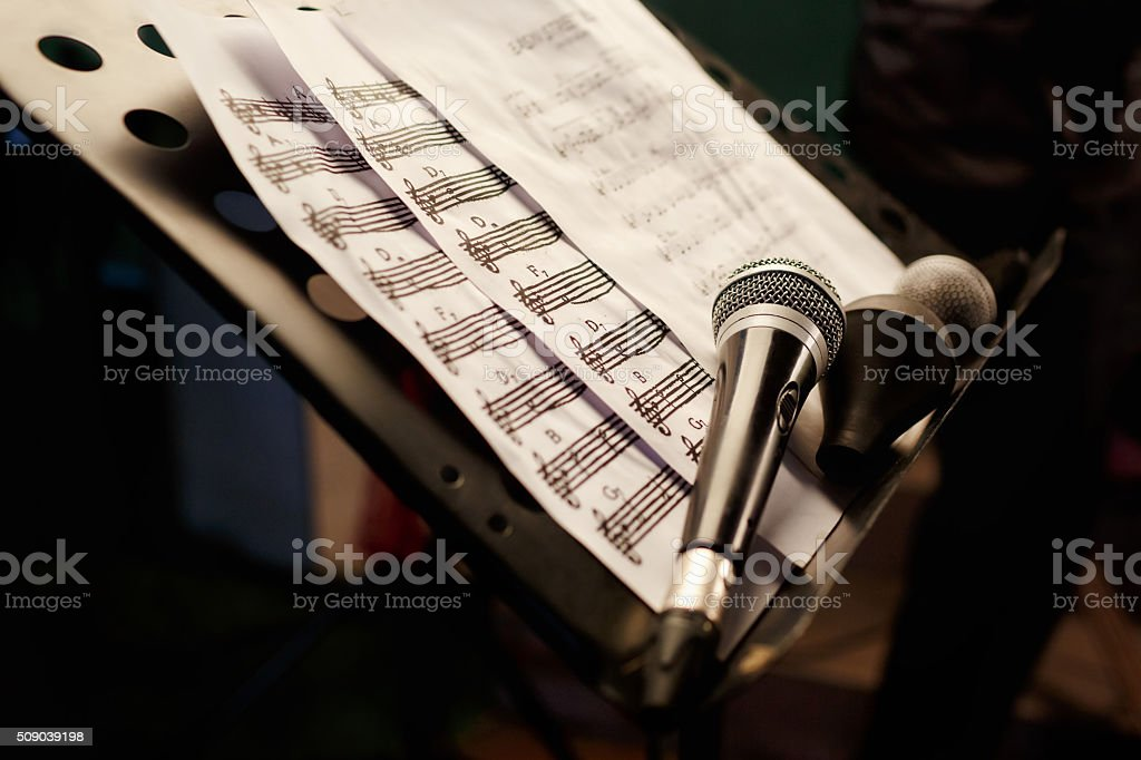 The microphone with notes. Karaoke singing rehearsal. stock photo
