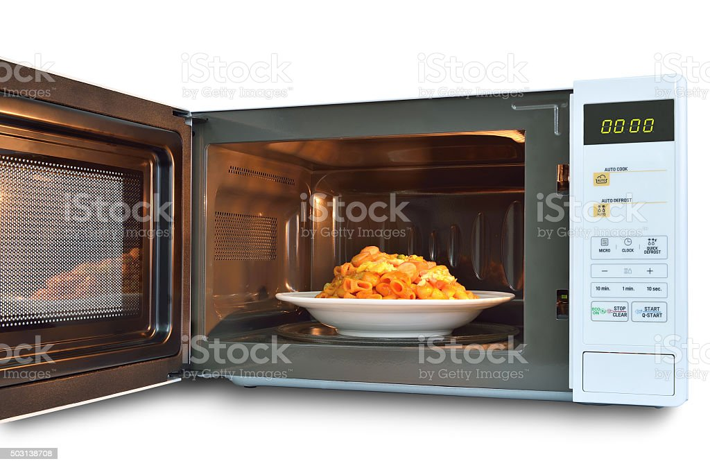 The microwave oven is warm stir Fried Macaroni. stock photo