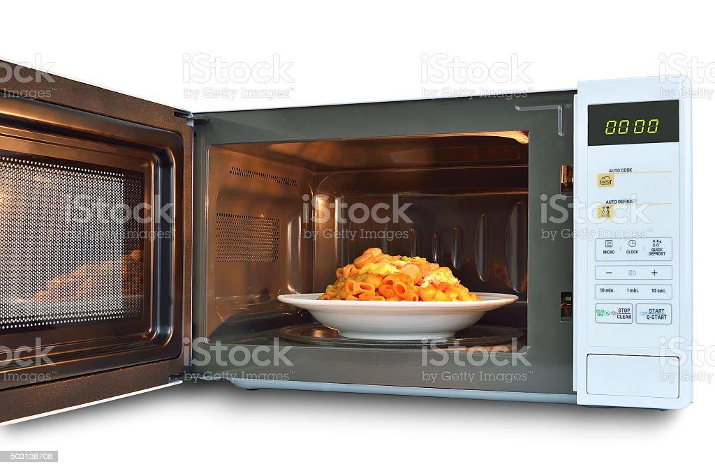 The microwave oven is warm stir Fried Macaroni. stock photo