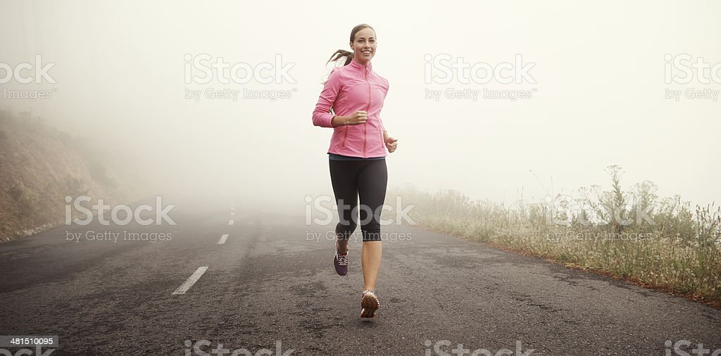 The miles are rolling away behind her stock photo