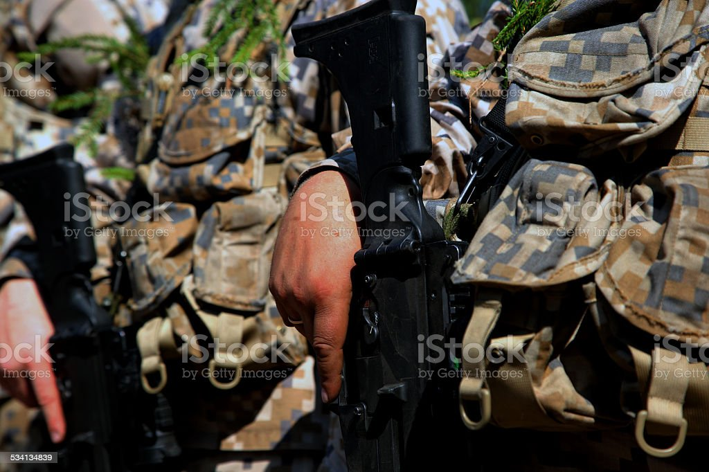 The military person with weapon stock photo