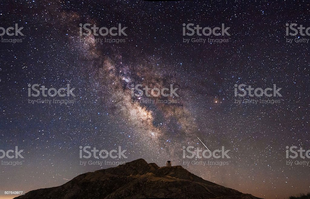 The milky way and a shooting star royalty-free stock photo
