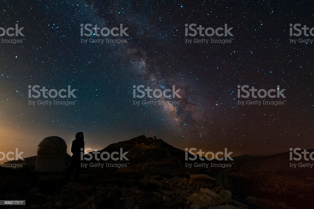 The milky way and the observer royalty-free stock photo