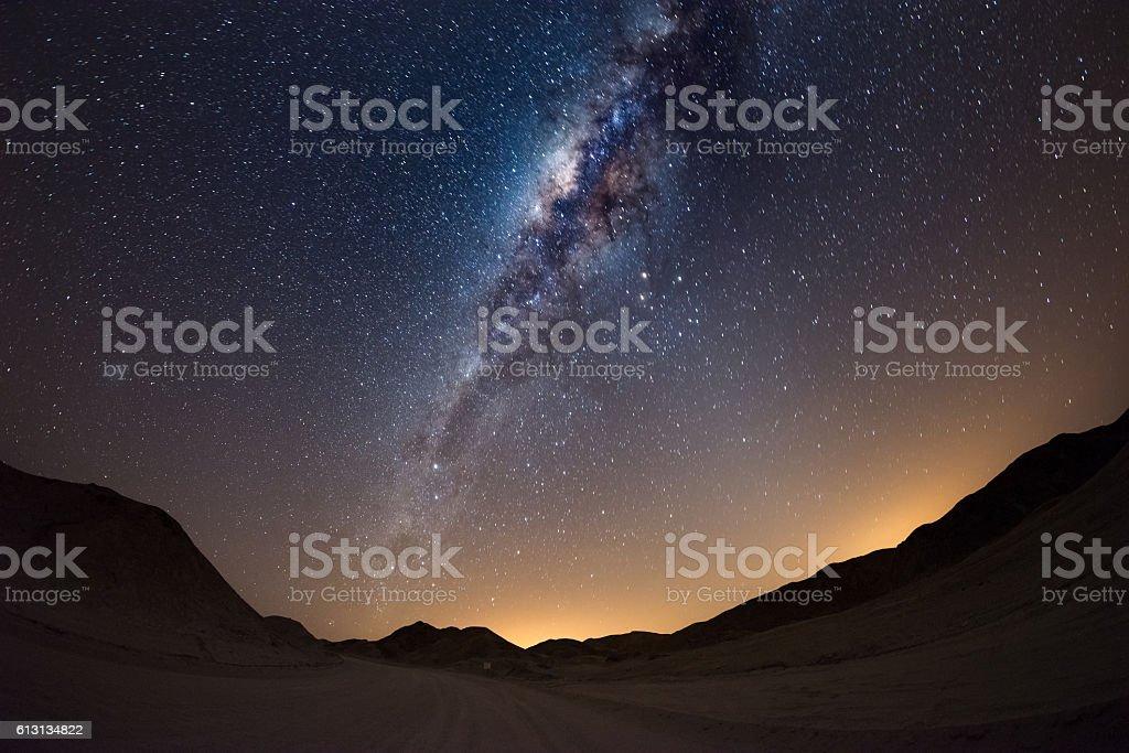 The Milky Way arc over the Namib desert, Namibia stock photo