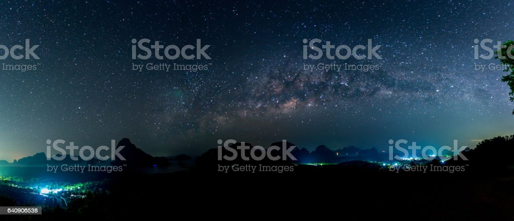 The Milky Way over moutain and ocean phanga thailand stock photo