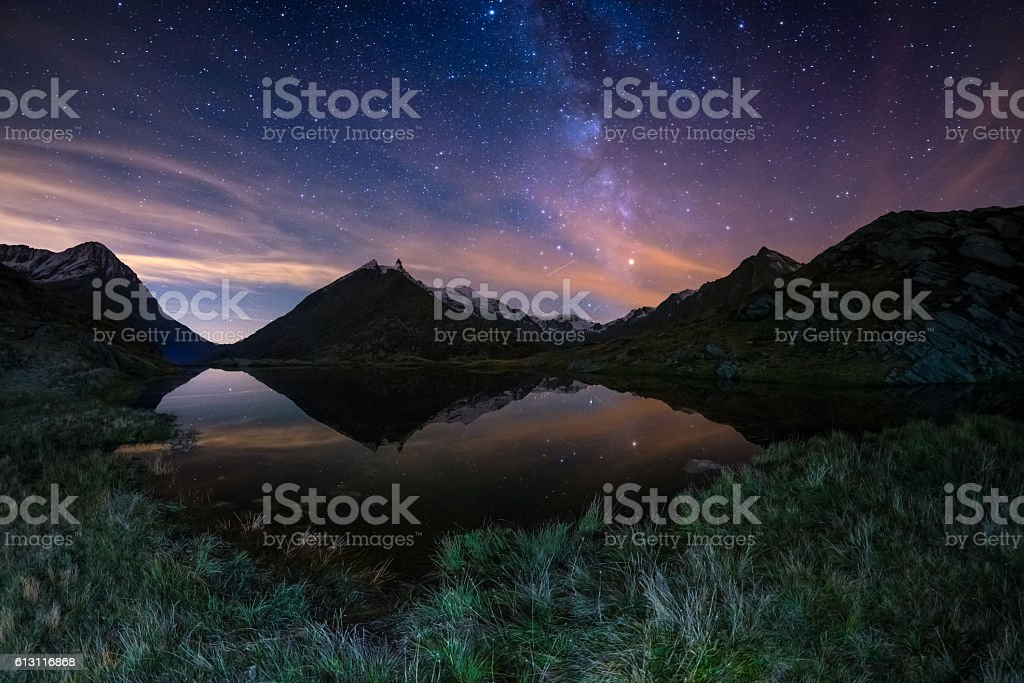 The Milky Way reflected on alpine lake, fisheye view stock photo