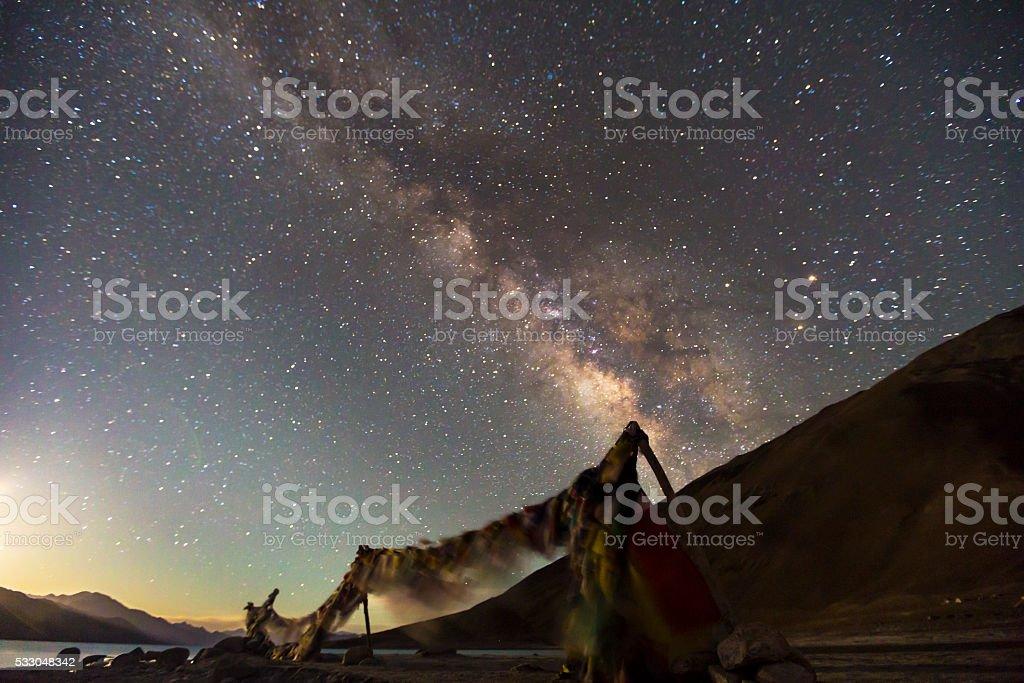The Milky Way rises over pangong lake in Leh India. stock photo