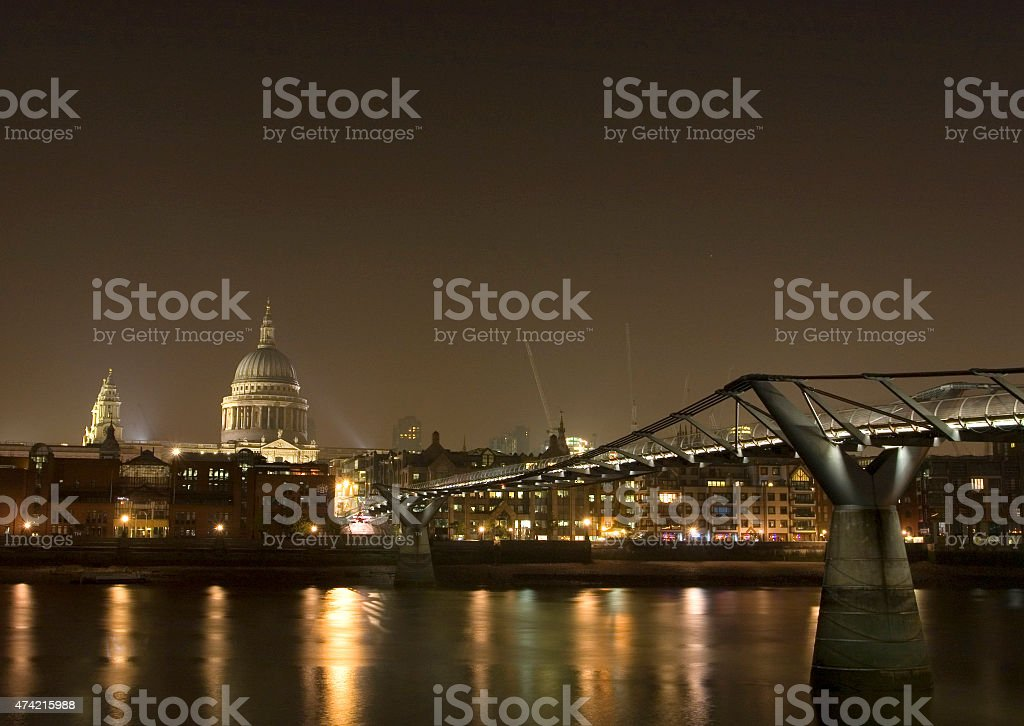 The Millenium Bridge and saint Paul Cathedral by night stock photo
