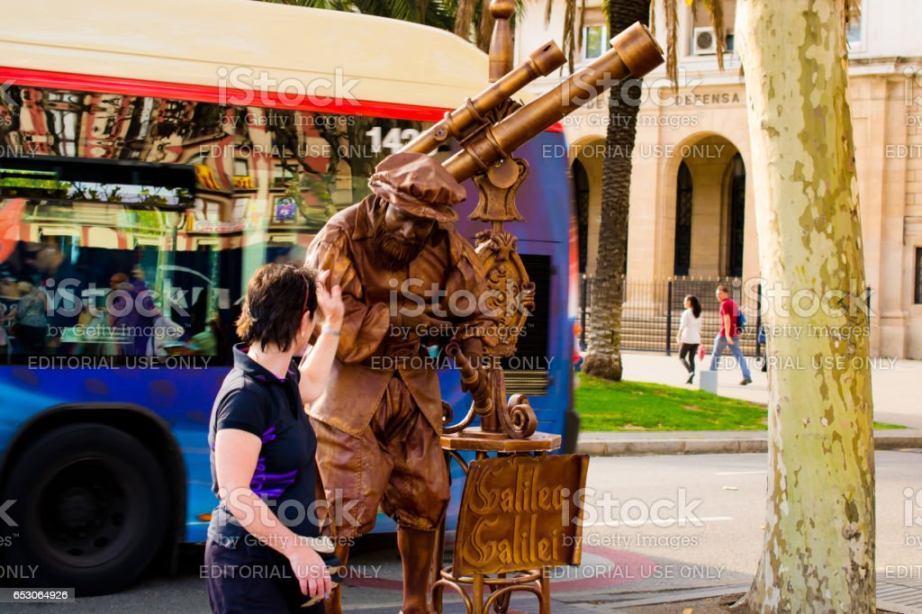 BARCELONA, SPAIN - OCTOBER 14: The mime represents a monument to Columbus., famous La Rambla street, Barcelona, Catalunia, Spain on October 14, 2013. stock photo