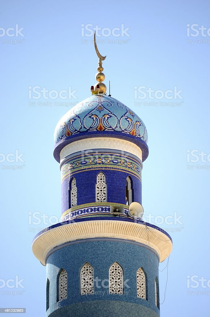 The minaret of the mosque of the great prophet in Muttrah, Oman. stock photo