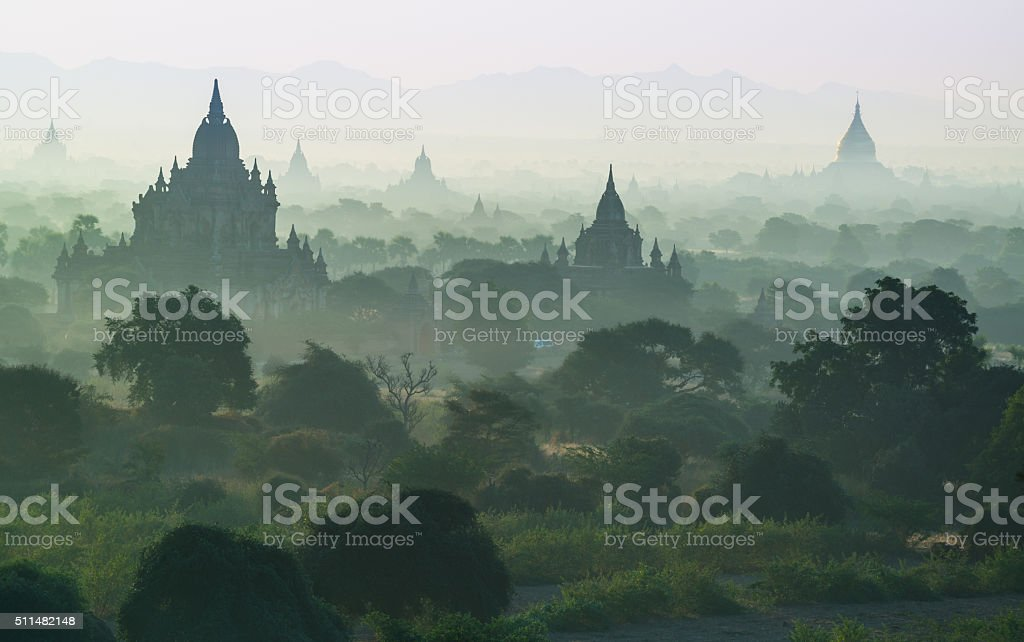 The mist with silhouette of ancient temple in Bagan. stock photo