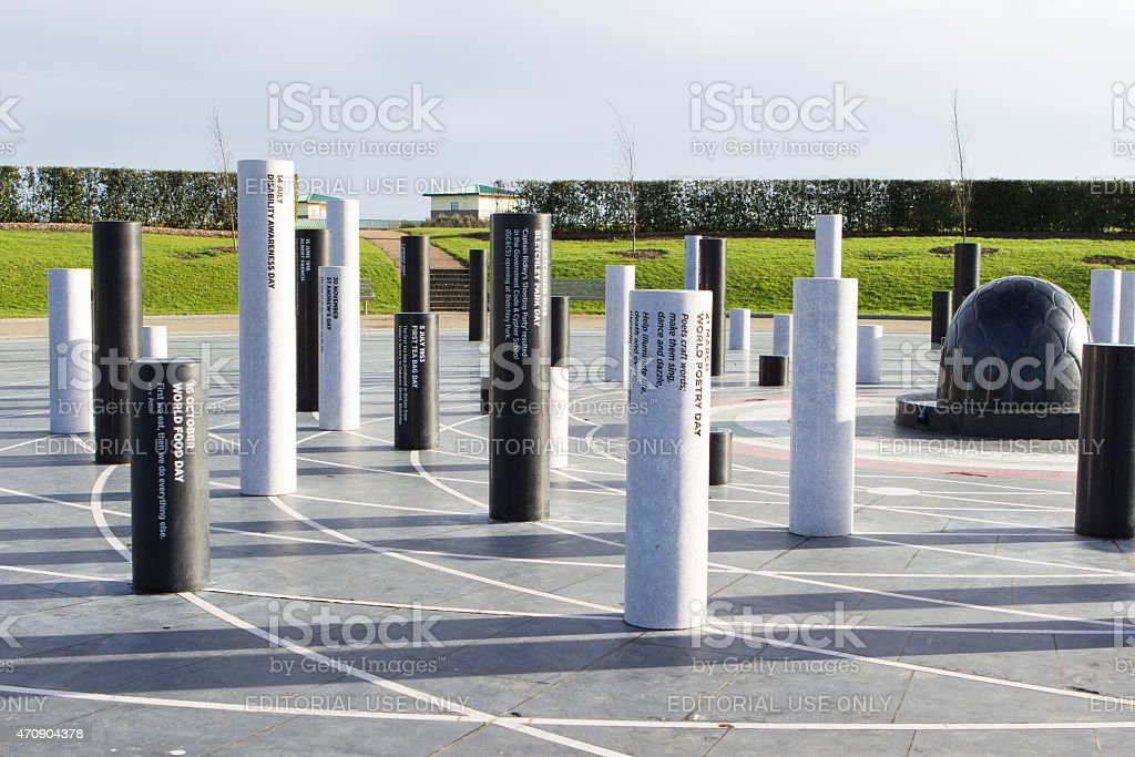 The MK Rose monument and pillars under cloudy sky stock photo