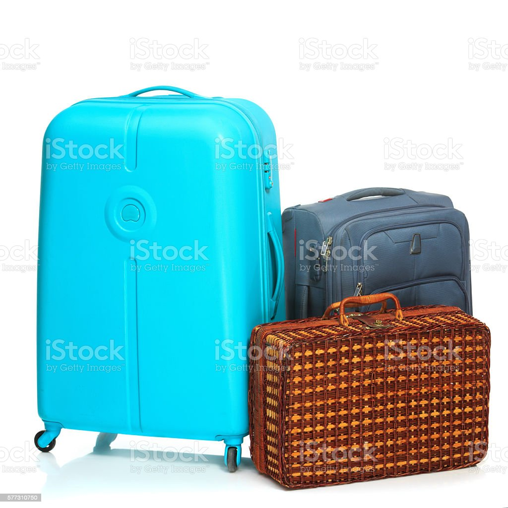 The modern and retro suitcases on white background stock photo