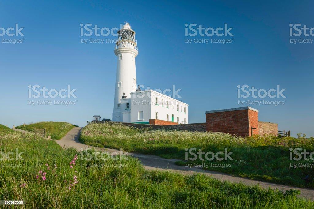 The modern lighthouse at sunrise, Flamborough Head, Yorkshire, UK. stock photo