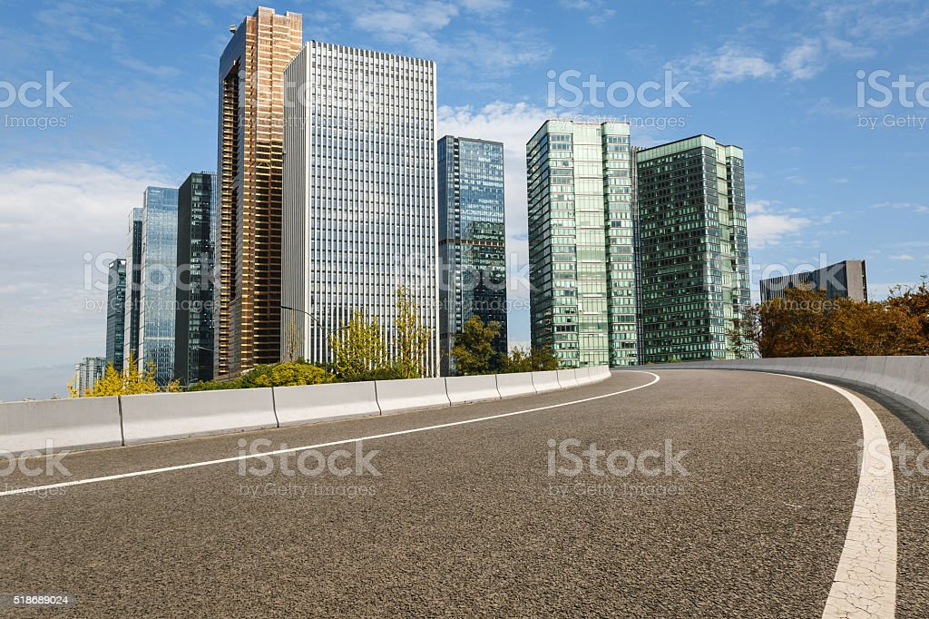 The modern urban commercial building and asphalt road stock photo