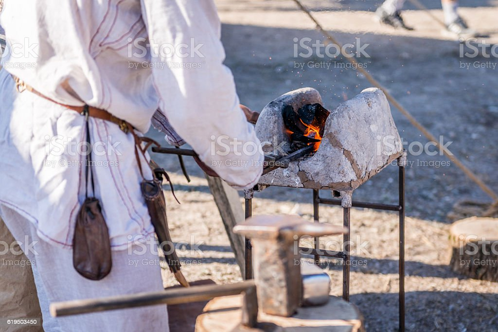 The molten metal in the forge of a blacksmith stock photo