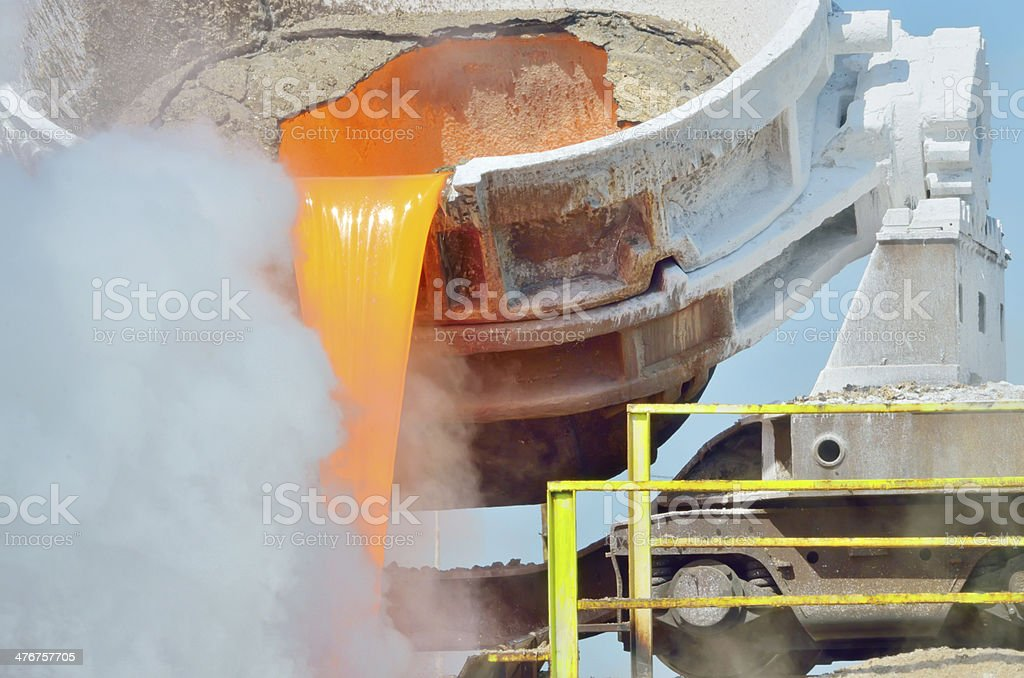 The molten slag is poured from a cup royalty-free stock photo