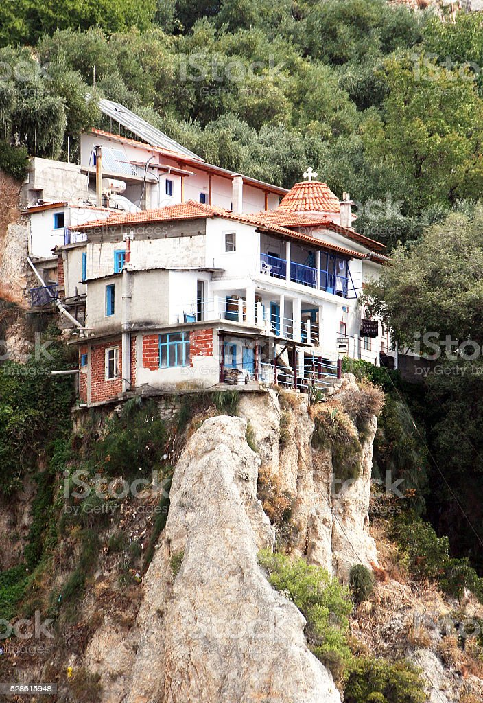 The monastic monastery located a ledge of Athos mountains. stock photo