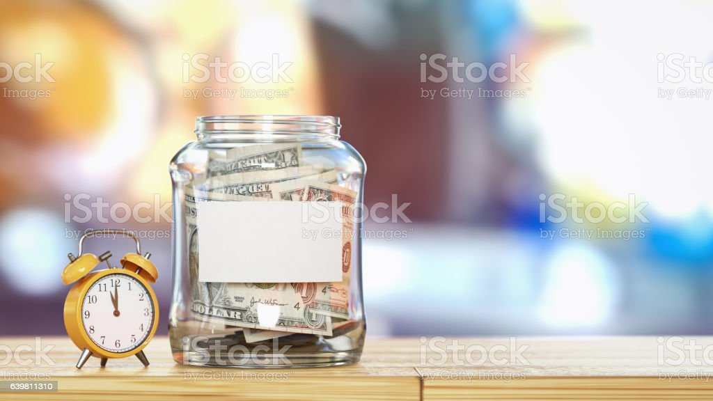 The money is in a glass bottle. stock photo