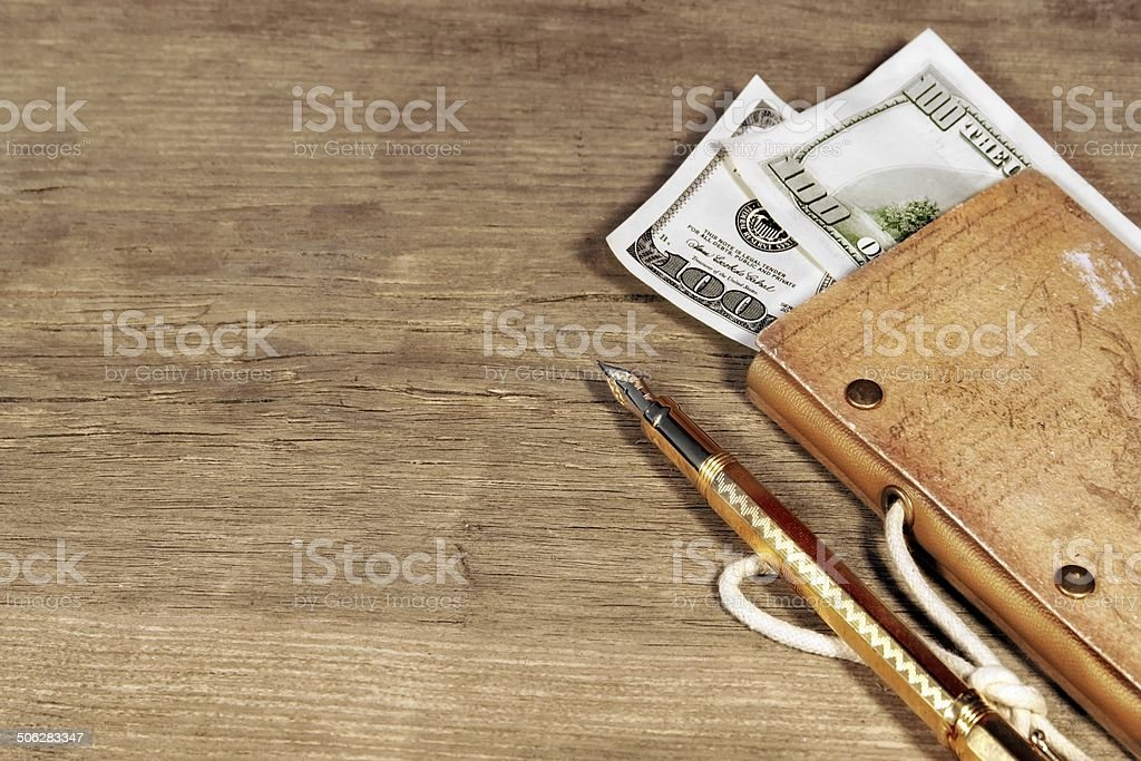 The money, vintage notebook  to trip and gold pen stock photo