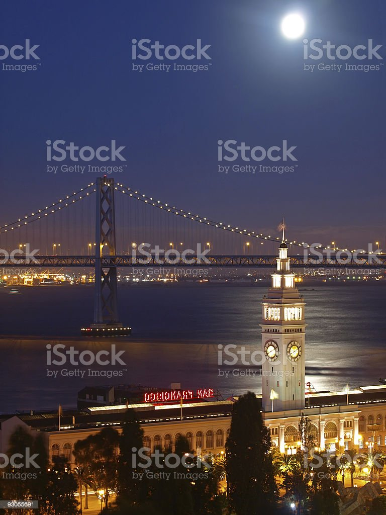 The moon above Ferry Building & Bay Bridge royalty-free stock photo