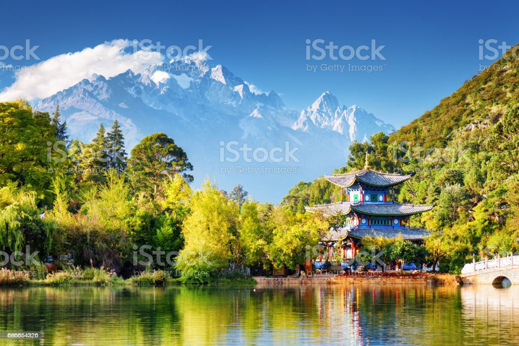 The Moon Embracing Pavilion and the Jade Dragon Snow Mountain stock photo