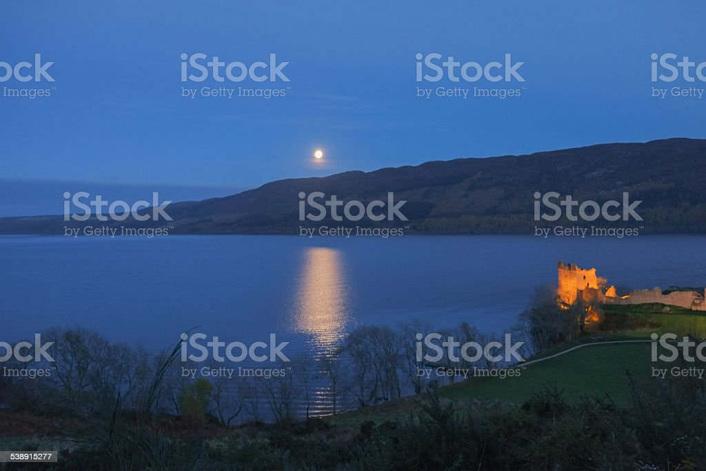 The moon rises in the Loch Ness over night stock photo