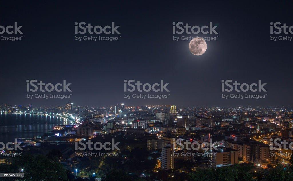 The moon sets stock photo