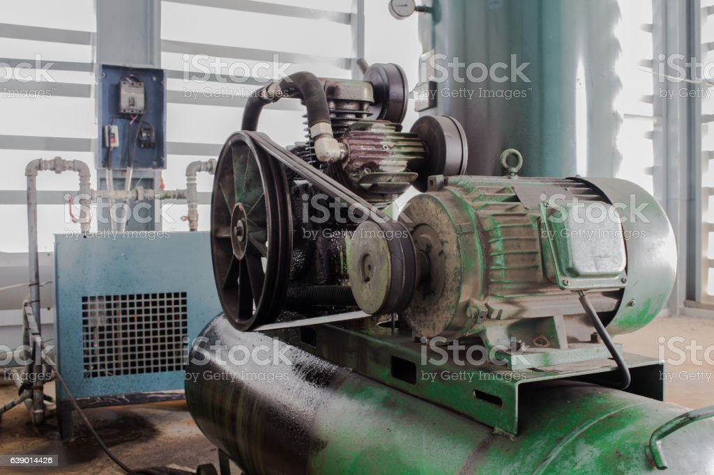 The Motor and Pulley on air compressor stock photo